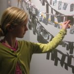 Visitor adding their artwork to Ex Voto.