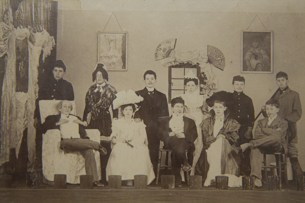 Summer Fields school photograph of 'A Regular Fix' cast in costume including Moseley in centre back (1900).