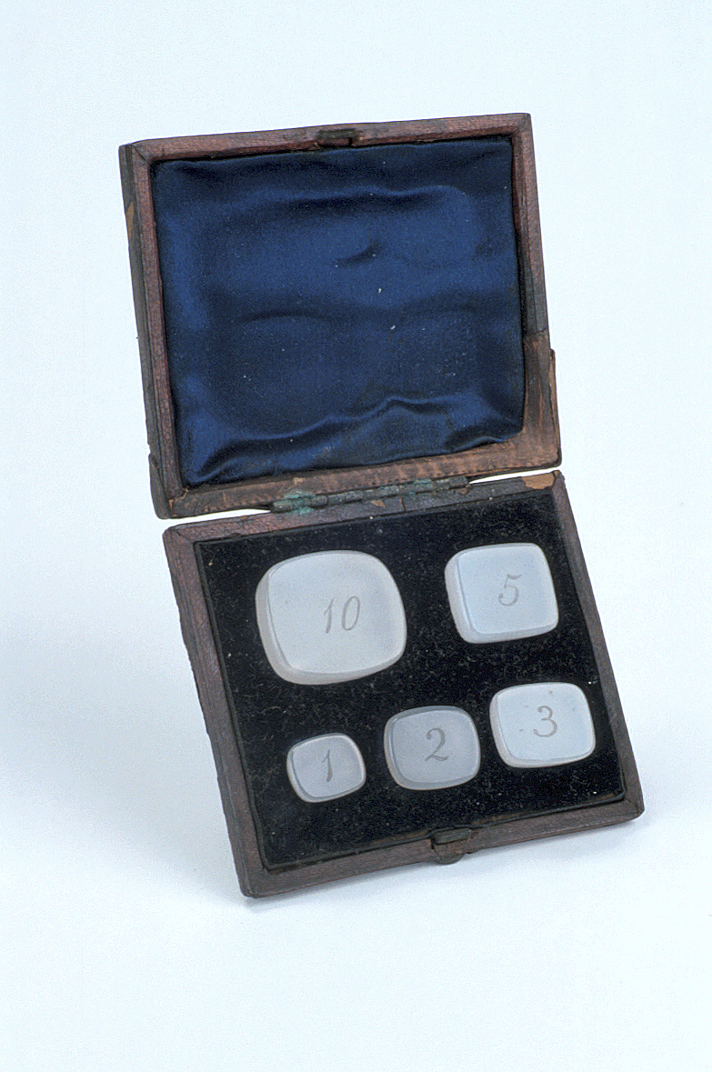 preview image for Five Agate Weights in Red Leather Case, Late 19th Century