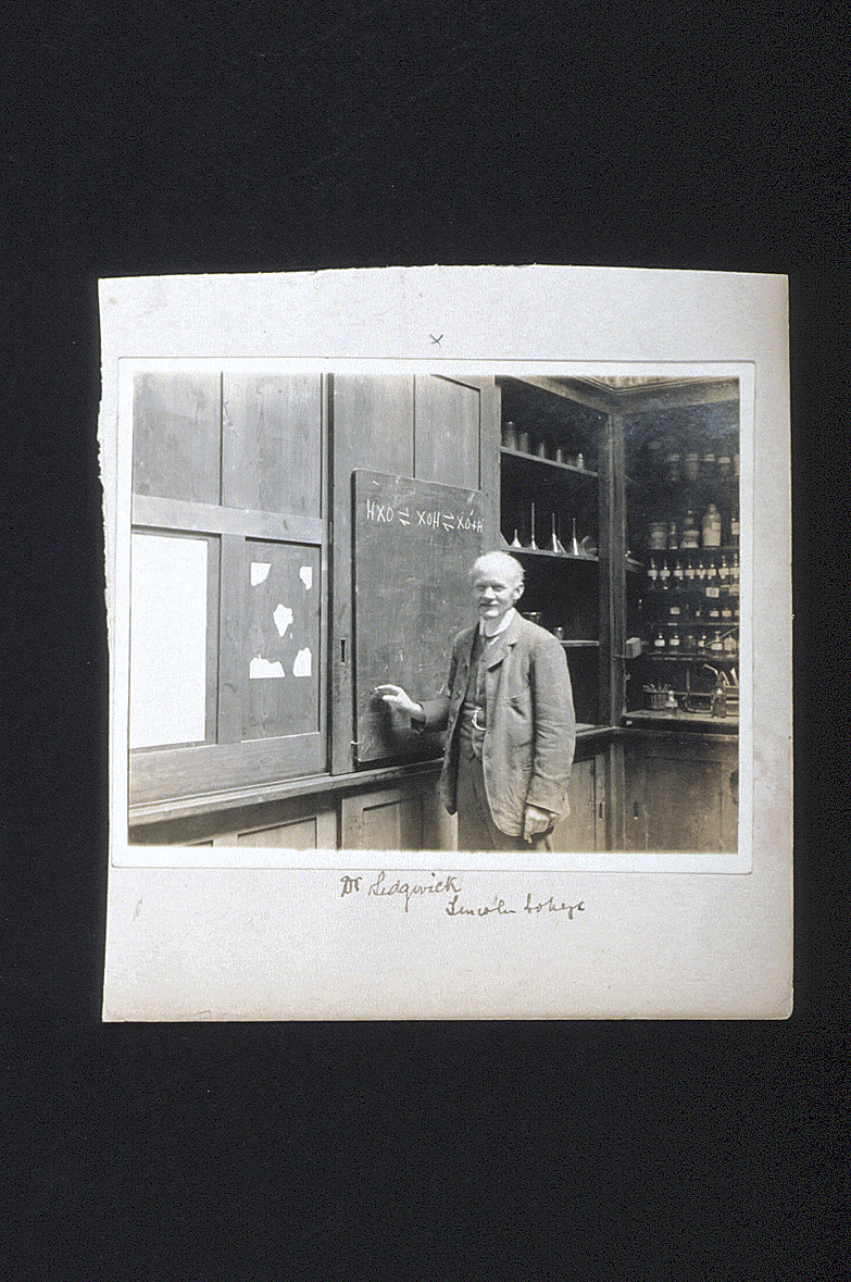 preview image for Photograph (Gelatine Print) of N. V. Sidgwick at a Blackboard in the Balliol-Trinity Laboratories, Oxford, 1910