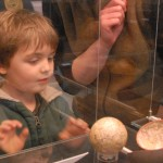 boy looking at small globe