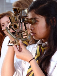 student handling a sextant