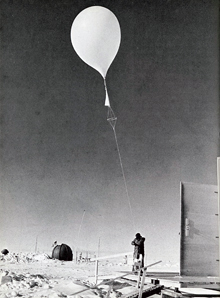 Launching a balloon carrying a combined radiosonde, radiometersonde and ozonesonde in Antarctica, 1968.