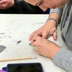 A member of staff making a votive for Ex Voto artwork.