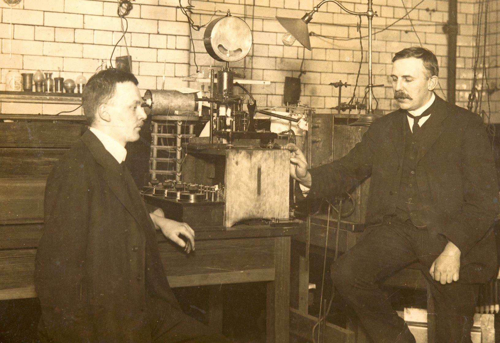 Ernest Rutherford and Hans Geiger (of Geiger tube fame) in the Manchester physics laboratory, 1912.
