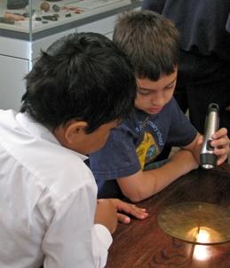 Children using a sundial